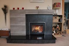 Contura i5 wood stove with porcelain tiled mantel and honed slate hearth