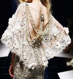 beaded on lace.The pollera inspiration. Inplace of pearls use the etnic jewerly