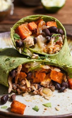 Sweet potatoes, black beans, chicken, cheese, and rice come together to make a protein packed burrito that's perfect for freezing.