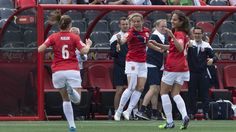 Norway's Trine Ronning (C) celebrates with teammates Maren Mjalde (L) and Ingrid Moe Wold after scoring the first goal against Thailand during a Group B match at the 2015 FIFA Women's World Cup at Landsdowne Stadium in Ottawa on June 7, 2015. AFP PHOTO/NICHOLAS KAMM