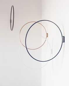 Ring Wandobject - movable hinged metal hangers / sculptures - designed by Zascho Petkow for Atelier Haußmann.