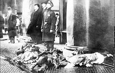Corpses lay on the street below as the Triangle Shirtwaist Factory fire blazes in New York, March 25th, 1911