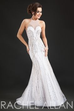 Fully beaded gown with high neckline. Order today by calling Everything for Pageants at 1-815-782-8877 and ask for our current promotions.
