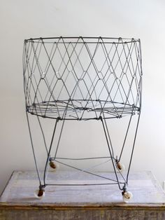 Vintage wire laundry hamper (or holder of other items).