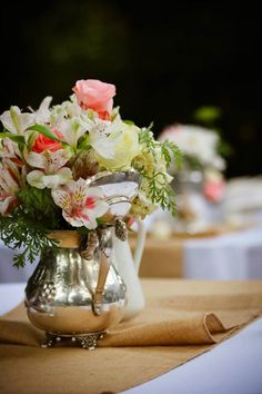 Understated wedding flower arrangements. I like the rustic looking camel with the elegant metalics