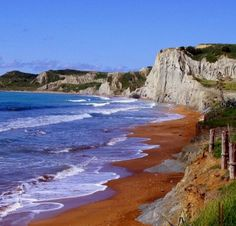 Xi beach is famous for its red sand and purifying clay. Kefalonia Island / by silvia07 via Flickr