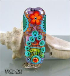 3 dimensional Flower design in pink, red, coral, turquoise, dark green  - lampwork focal bead by MICHOU. $129.00, via Etsy.