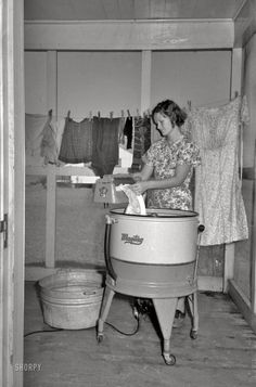 "September 1938. ""Farm wife washing clothes. Lake Dick Project, Arkansas."" 35mm negative by Russell Lee, Farm Security Administration."