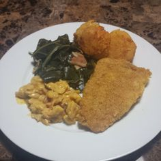 Home made dinner for sweet heart.  Work all day and still come home and cook. Collard Greens, Mac and cheese, hush puppies and fried fish.