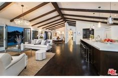 LOVE! The home actress Mila Kunis recently sold in the Hollywood Hills is notable for its sophisticated palette of high-contrast neutrals and lavish use of wood.