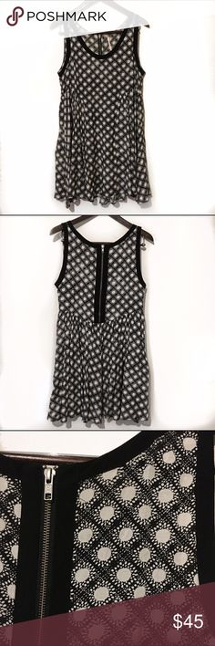 Free People trapeze style dress Perfect for spring adorable loosely flowing trapeze style dress by free people. Black-and-white with spotted pattern all over features a zipper in the back. Free People Dresses Mini