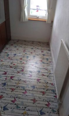 Decoupage floor, using wallpaper with backing removed, rustic style, done on paint splattered old floorboards, then coated with Wilkinsons tough varnish