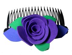 Purple color flower comb pins (one flower), made of imported  rubber sheets, beautifully designed by village women, giving a   new fashion style to hair accessories.  Color: Purple   Material: Imported Rubber sheets  Base material: Imported plastic Comb pin