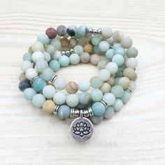 Say it and Wear it in style with Amazonite! This handcrafted mala bracelet made with natural Amazonite Beads with a matte finish, is of the highest quality and paired with a beautiful lotus coin charm. Amazonite is a mint green to aqua green stone said to be of truth, honor, communication, integrity, hope, and trust. It is said to enhance intuition, psychic powers, creativity, intellect, and psychic ability.Amazonite is often associated with the throat chakra, and as such, said to be…