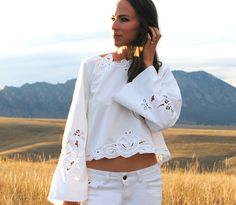 No use crying over spilled wine...This originally was a table cloth that had a wine stain right down the middle.  I loved the detailing so much I created this blouse/jacket that can be worn both ways.  The eyelet and scalloped embellishments are showcased along the edges. No use crying over spilled wine…It looks much better as a blouse...