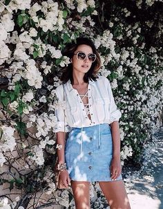 Pretty laced front top with denim mini skirt.