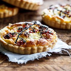 Fragrant, slow-roasted tomatoes is the perfect partner for peppered goat's cheese in this delicious quiche recipe with home-made pastry.