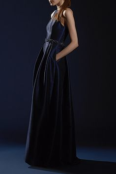 Always on board with a polished gown that has pockets!