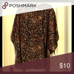 Cheetah print kimono. NEVER been worn Flowy. Light weight. Open winged sleeves. Comes to mid thigh. Other