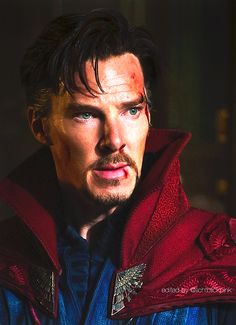Victorious Doctor Strange with his new friend (the cloak).