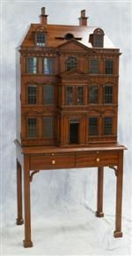 WMaitland Smith Curio Cabinet in the style of a 4 story house with hinged front, roof opens, on a block foot base.