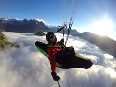 Photo of the Day! Paragliding above the fog layer in the Engelberg Valley, Switzerland. Photo by Paul van den Berg. #GoPro #paragliding #Switzerland