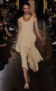 Stella McCartney Summer '15  Look 17 butter and creme ribbed volume sleeveless top and volume skirt, butter plexy necklace and Darcy slide.