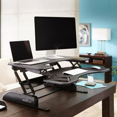 Our best selling model! The Pro Plus 36 is a standing desk sized to accommodate those with dual-monitor setups or larger workspace needs. The two-tiered design with separate keyboard/mouse deck gives you plenty of room for basics and accessories with the added convenience of never having to move any components when raising or lowering your VARIDESK.