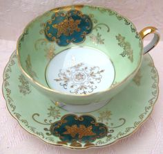 Stunning Tri Footed Green and Gold Teacup and Saucer- Royal Sealy, Japan. $36.00, via Etsy.
