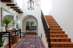 In the entry of a 1930s Spanish Colonial home the cleaned and restored tiles are original to the home, as is the light fixture that hangs overhead | archdigest.com