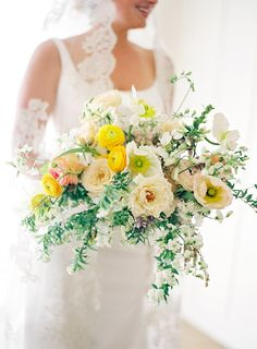 Colorful bridal bouquet with pops of yellow by Sarah Winward.
