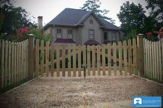 residential wood picket driveway gate