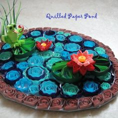 Beautiful 3D Quilled paper pond by Instructables user manuja (tutorial at link)