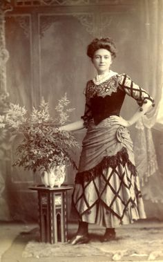 Edwardian lady in a lovely fancy dress. She may have worked as an actress or dressed up for carnival.