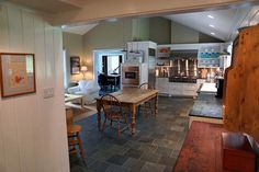 Chef's kitchen has honed marble countertops, professional series appliances, heated tile floors, and Woodmode cabinets.