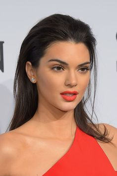 One Small Note About Overlining Your Lips to Take From Kendall Jenner red lip slick hair make up red dress