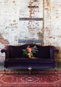 Pinspiration: Add A Touch Of Luxury With Velvet Decor Purple Velvet Couch, Exposed Brick Wall and Red Oriental Rug Make For A Stunning Color Combination Decor, Furniture, Interior, Velvet Decor, Decor Inspiration, House Interior, Apartment Decor, Trending Decor, Interior Design