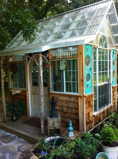 Bob Krekelberg adds found objects to his building projects, like the pressed glass plates in the greenhouse walls. (Anne Krekelberg/Special to The Commercial Appeal) http://memne.ws/KxP2uT  The glass plates used in the walls for mini portal windows is so original