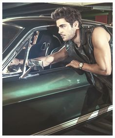Zac Efron... with a classic fast back Mustang and those sexy arm muscles.. oh damn its too much