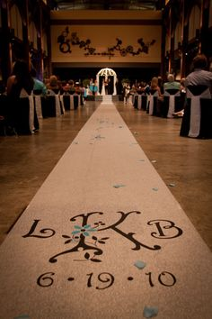 Aisle Runner - custom made for a wedding. This would be So simple - get yards & yards of burlap & paint on it. Sweet!