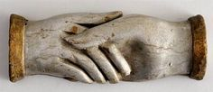 AMERICAN FOLK ART CARVED AND PAINTED MODEL OF CLASPED HANDS.