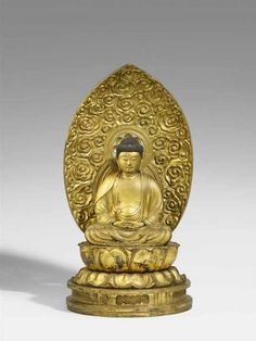 A large lacquered and gilded wood figure of Amida Nyorai. 18th century A large lacquered and gilded wood figure of Amida Nyorai seated in meditation on a double lotus throne above a low lobed base, the hands held in amida-jôin above the feet, a mandorla carved with clouds and lotus flower inserted into the base, both urna of glass. Extensive overpainting and restoration to the neck. Along with five pieces of writing including printed segments of the Lotus Sutra, possibly from the inside of…
