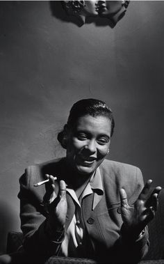 Billie Holiday, 1949, photographed by Herman Leonard.