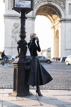 All black. Love the flared leather midi skirt.