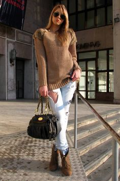 Bucharest , Romania Who: Alexandra, 19 What: Student Wear: Mango jeans and bag, Zara pullover and boots, Ray-Ban sunglasses   Read more: Global Street Style - Discover More Street Style  Follow us: @ElleMagazine on Twitter | ellemagazine on Facebook  Visit us at ELLE.com