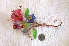 Copper Wire Flowers detailed and handmade with by MollyRobertsArt. https://www.etsy.com/listing/206912901/copper-wire-flowers-detailed-and?ref=shop_home_active_1