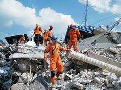 Rescuers searching rubble