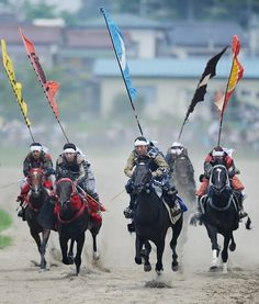 "Local people in samurai armor race horses during the annual Soma Nomaoi Festival in Minamisoma, Fukushima Prefecture, on July 29, 2012. Some 400 horses and thousands of people took part in the 1,000-year-old ""Soma Nomaoi"", or wild horse chase, at the weekend in the shadow of Japan's crippled Fukushima nuclear plant. (Photo by Toru Yamanaka/AFP Photo)"