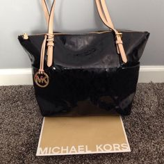 one day saleMichael kors signature vinyl tote Used for about a month, in nearly perfect condition, just small imperfections on the bottom, straps look brand new, open to reasonable offers, no trades Michael Kors Bags Shoulder Bags