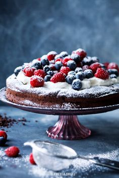 Chocolate cake with mascarpone cream and fruit. It can be done with strawberries instead of raspberries and blueberries. Ingredients: Falling chocolate cake: • 125 g of butter • 125 g of sugar • 300 grams of dark chocolate • 2 tablespoons vegetable oil • 6 eggs (large, L) • 2 tablespoons cocoa bitter • pinch of salt See all the recipe here and  translate it in google translator.